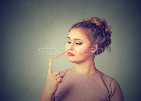 Woman with long nose. Liar concept. Human face expressions, emotions, feelings. Stock photo © ichiosea