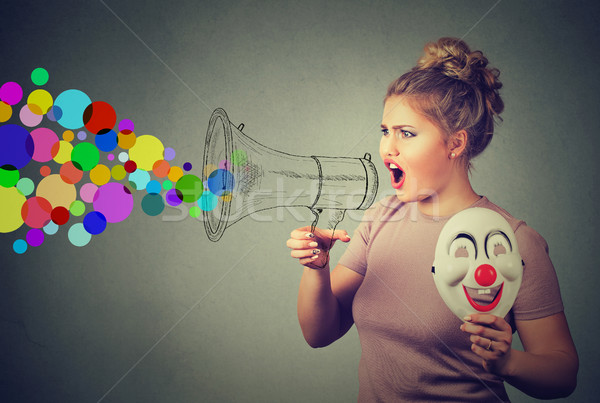 Woman screaming in megaphone. Propaganda social media communication concept Stock photo © ichiosea