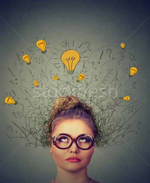 Gondolkodik nő szemüveg kérdés feliratok fény Stock fotó © ichiosea