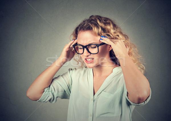Triste mulher jovem óculos preocupado cara Foto stock © ichiosea