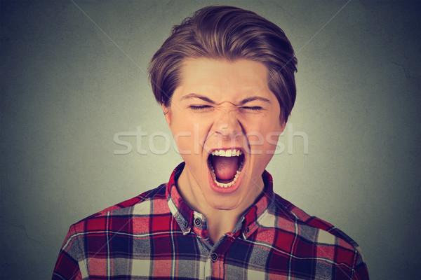 Retrato jovem zangado homem gritando Foto stock © ichiosea