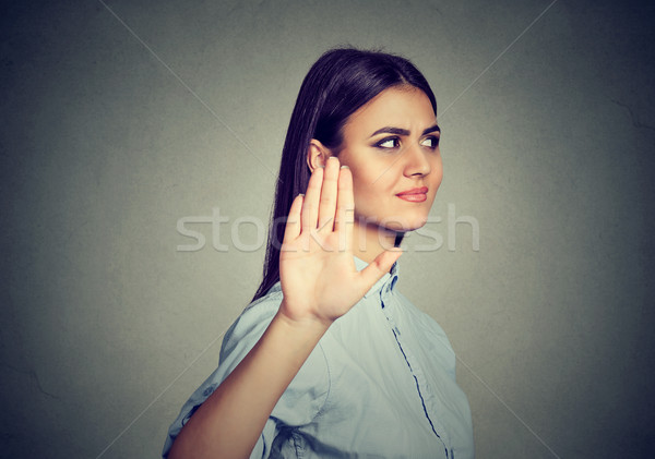 Upset angry woman giving talk to hand gesture with palm outward Stock photo © ichiosea