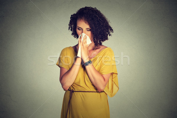 Middle aged woman sneezing in a tissue blowing her runny nose Stock photo © ichiosea