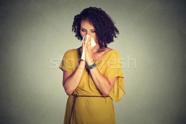 Középkorú nő papírzsebkendő fúj orr áll izolált Stock fotó © ichiosea