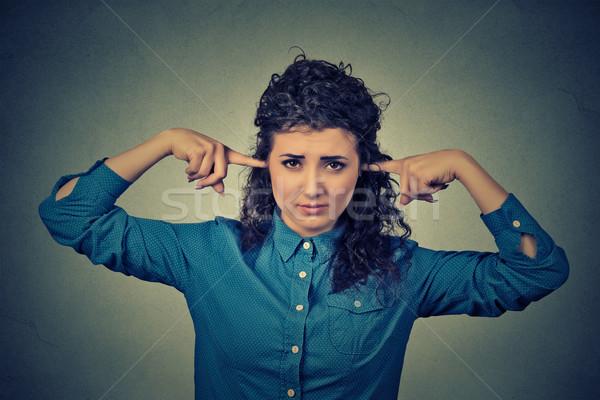 Portre üzgün kadın kulaklar parmaklar Stok fotoğraf © ichiosea