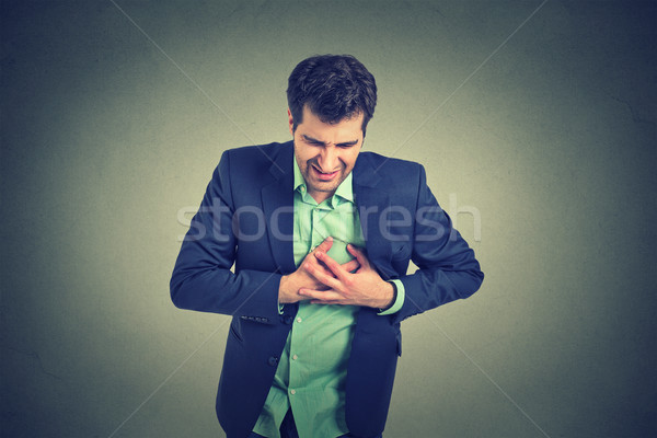 Man lijden scherp hartzeer borst pijn Stockfoto © ichiosea