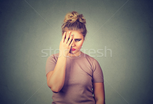 Sad young beautiful woman with worried stressed face expression looking down Stock photo © ichiosea