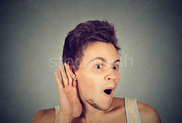 nosy shocked man with hand to ear gesture listening to gossip Stock photo © ichiosea