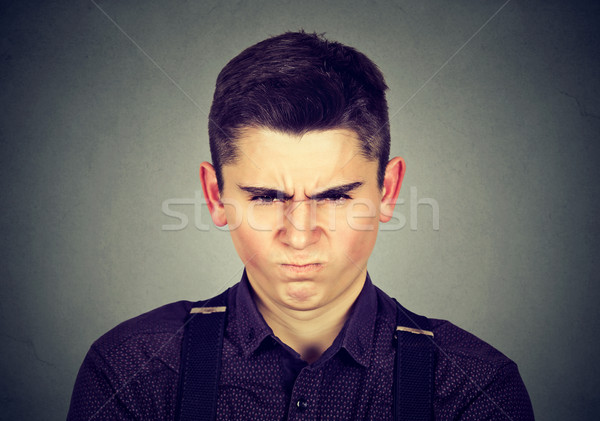 Stock photo: angry young man about to have nervous breakdown
