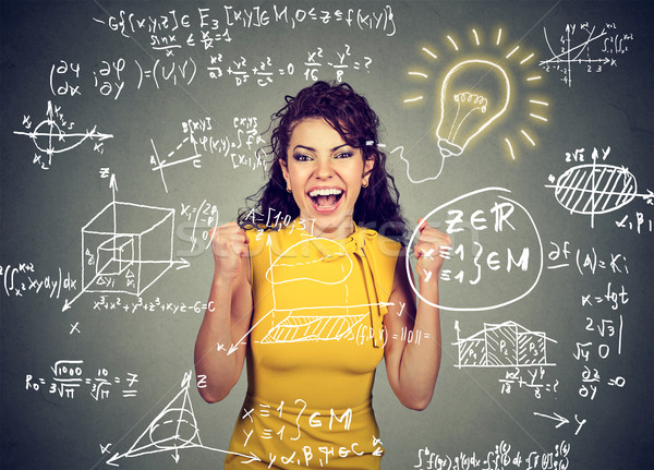 excited student with idea light bulb and maths and science formulas on blackboard Stock photo © ichiosea
