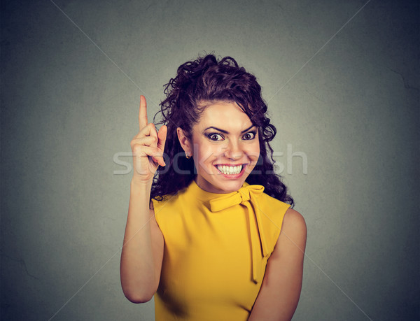 woman pointing finger up has a brilliant idea  Stock photo © ichiosea