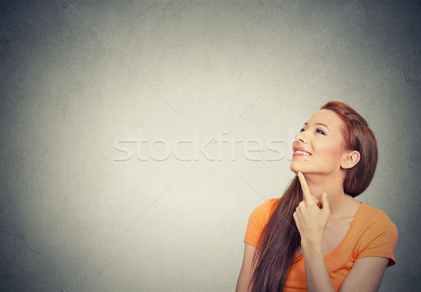happy beautiful woman thinking looking up Stock photo © ichiosea