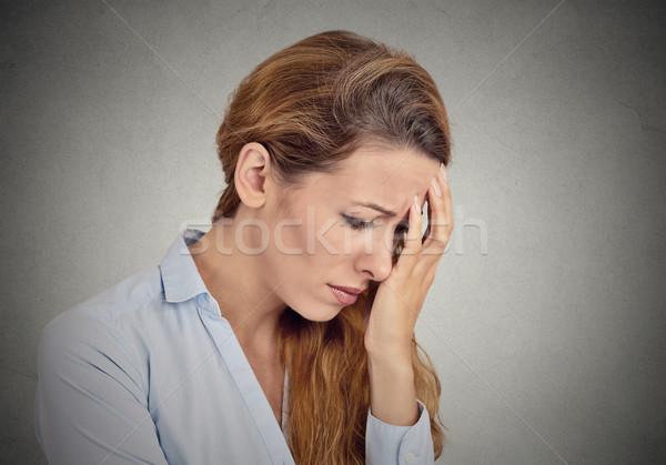portrait of sad young woman isolated on grey wall background  Stock photo © ichiosea