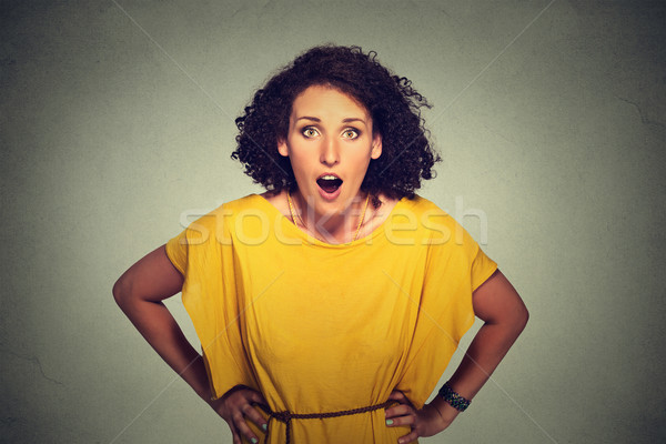 Surprised woman in yellow dress  Stock photo © ichiosea