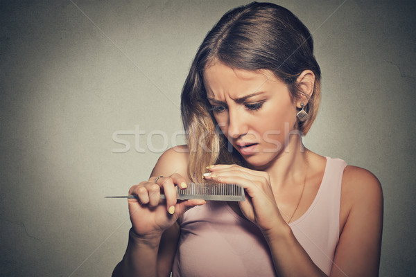 frustrated young woman surprised she is losing hair, noticed split ends Stock photo © ichiosea
