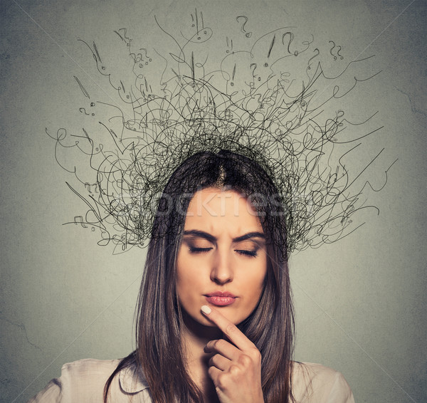 upset woman with worried face expression eyes closed and brain melting into lines Stock photo © ichiosea