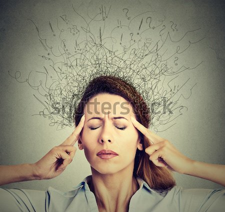 woman worried stressed eyes closed trying to concentrate brain melting into lines Stock photo © ichiosea