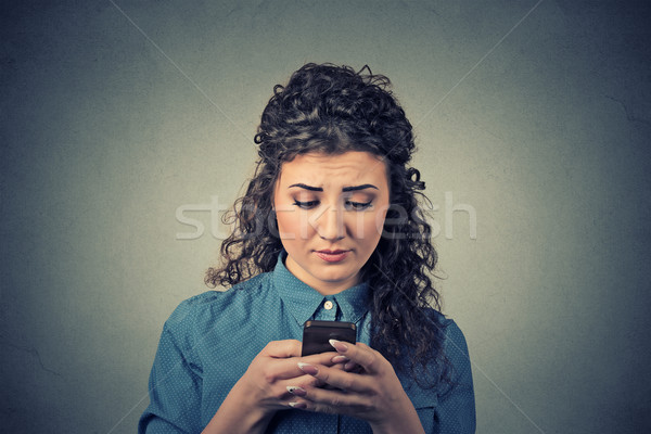 upset sad unhappy serious woman talking texting on phone Stock photo © ichiosea