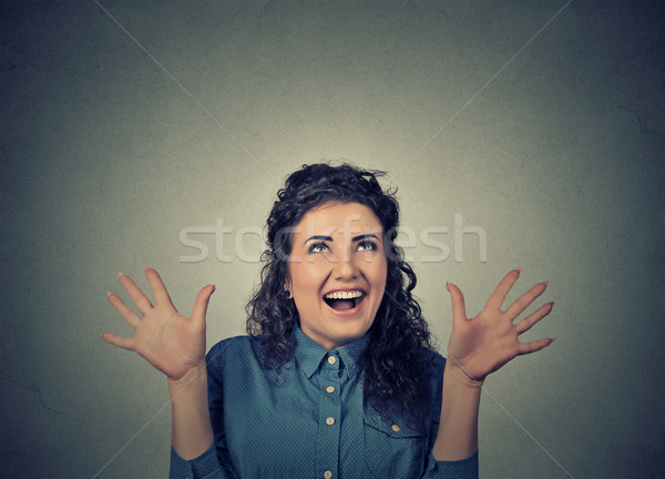 super excited funky girl looking up thrilled screaming  Stock photo © ichiosea