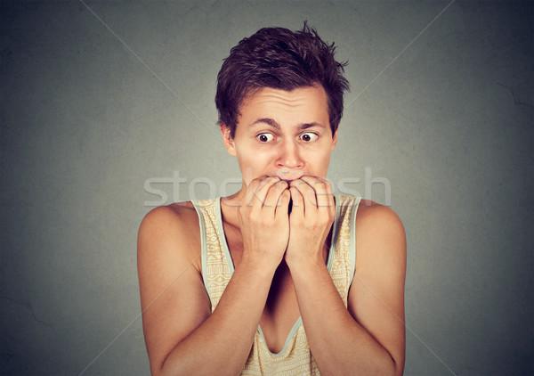 Retrato ansioso moço unhas dedos Foto stock © ichiosea