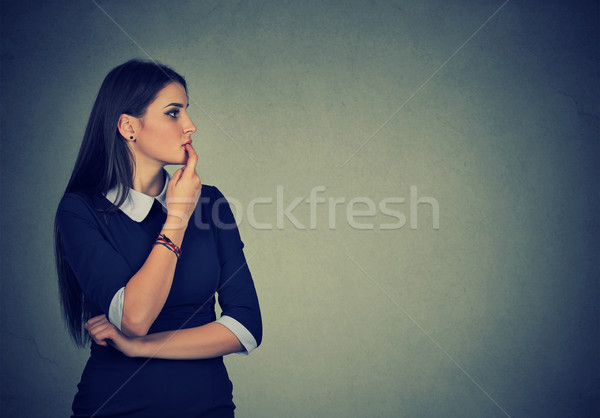 portrait of worried young woman looking to the side   Stock photo © ichiosea
