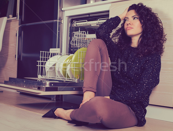 Stressed woman relaxing in the kitchen  Stock photo © ichiosea