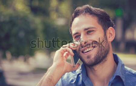 Headshot of a man talking on mobile phone outdoors  Stock photo © ichiosea