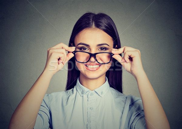 Happy woman taking off glasses smiling  Stock photo © ichiosea