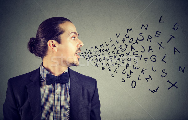 Man talking with alphabet letters coming out of his mouth. Stock photo © ichiosea