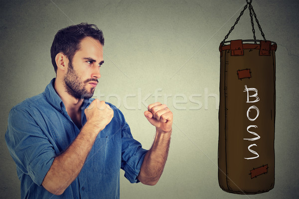 man ready to punch boxing bag with boss written on it. Employee employer relationship concept  Stock photo © ichiosea