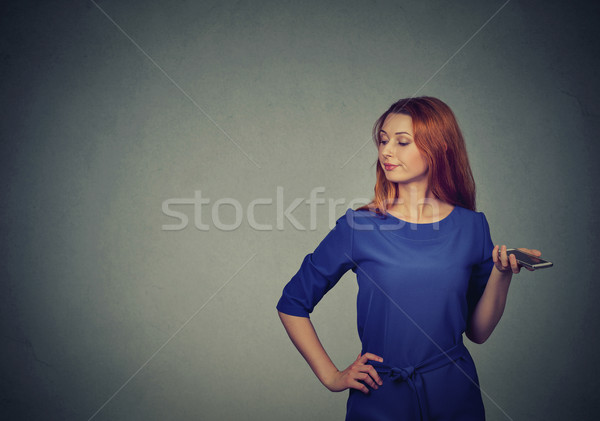 Portrait of an annoyed and frustrated young woman on the phone  Stock photo © ichiosea