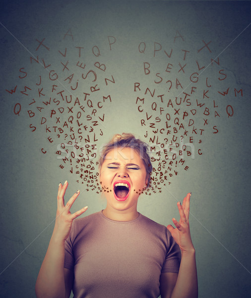 angry woman screaming, alphabet letters coming out of open mouth Stock photo © ichiosea