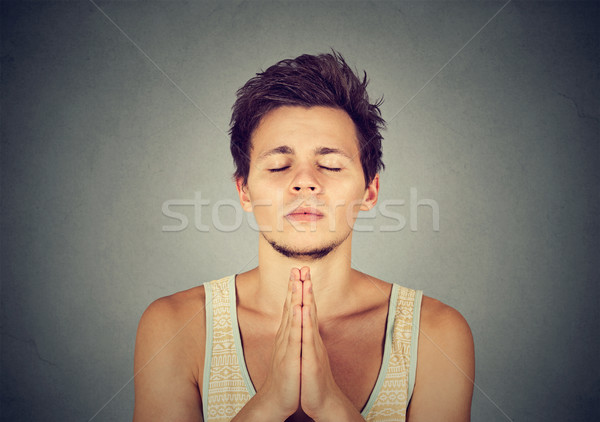 Man praying hands clasped hoping for best asking for forgiveness Stock photo © ichiosea