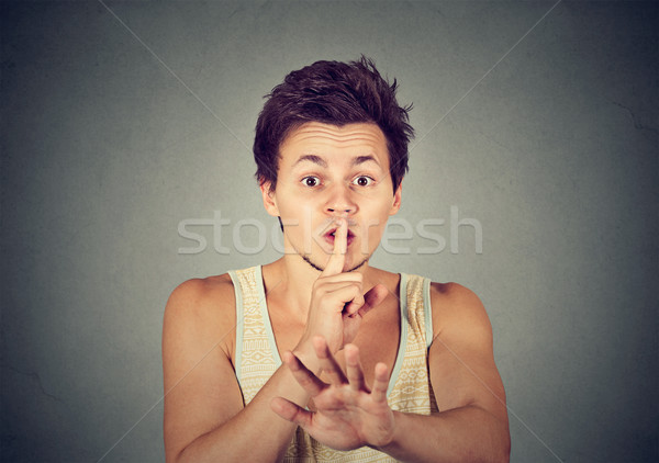 young handsome man giving Shhhh quiet silence secret gesture  Stock photo © ichiosea