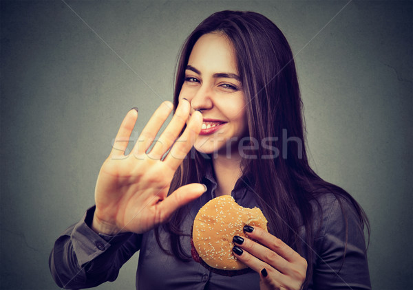 woman with hamburger rejecting advise on healthy eating  Stock photo © ichiosea