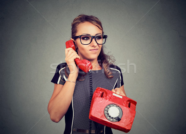 Grincheux jeune femme désagréable téléphone conversation Photo stock © ichiosea