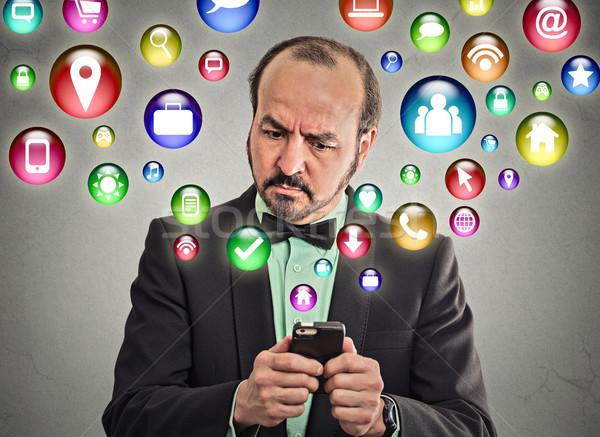 Férfi igazgató okostelefon üzletember vállalati sms chat Stock fotó © ichiosea