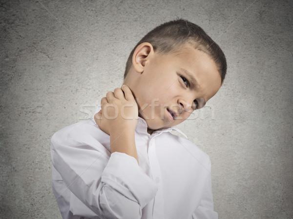Boy with neck pain Stock photo © ichiosea