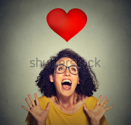 super excited funky girl looking up isolated on grey wall background Stock photo © ichiosea