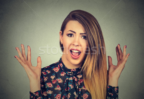 Surprised woman screaming. Shocked lady with her mouth opened hands arms up in air Stock photo © ichiosea