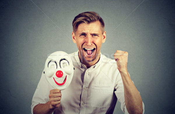 angry screaming man holding clown mask expressing cheerfulness happiness  Stock photo © ichiosea