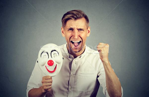Mérges sikít férfi tart bohóc maszk Stock fotó © ichiosea