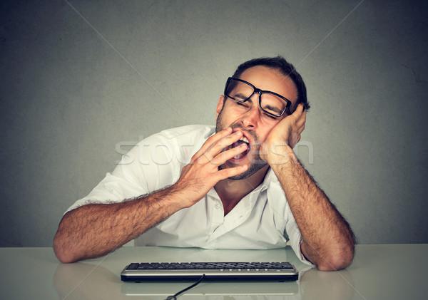 Sleepy worker man working on computer yawning  Stock photo © ichiosea