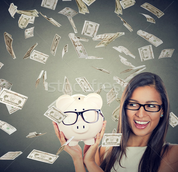 woman excited over savings under money rain falling down dollars Stock photo © ichiosea