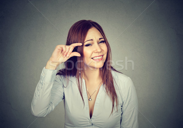 Woman showing small amount size gesture with fingers Stock photo © ichiosea