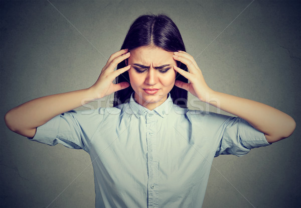 stressed out young woman with worried face expression looking down Stock photo © ichiosea