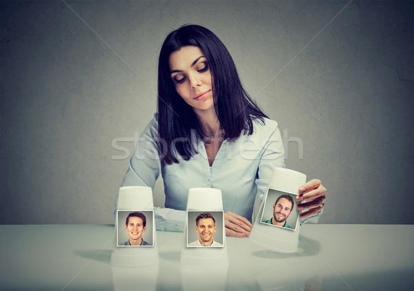 Woman playing a conjuring trick game making a boyfriend choice  Stock photo © ichiosea