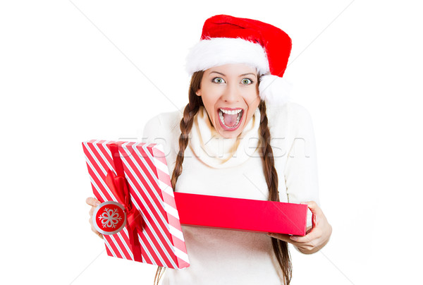 3983ca283f355  3698555 Excited christmas girl holding an opened gift box by ichiosea Stock  photo