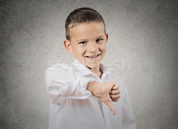 Happy boy happy someone failed, giving thumbs down gesture Stock photo © ichiosea