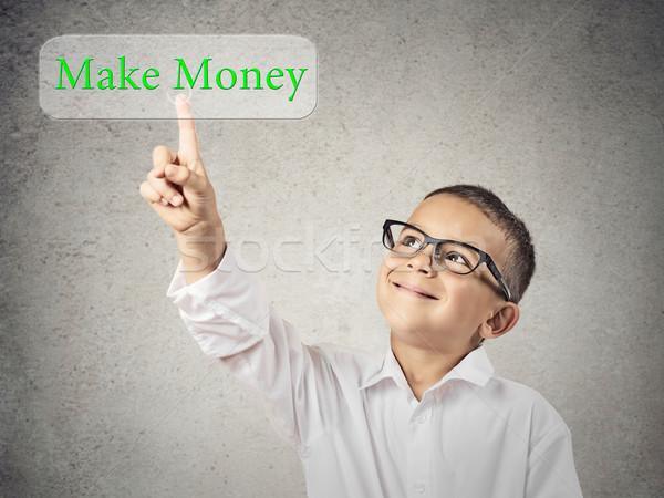Little man pressing make money button on touchscreen Stock photo © ichiosea